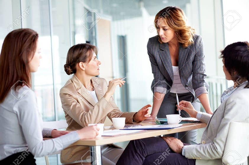 12620175 image of four businesswomen interacting at meeting