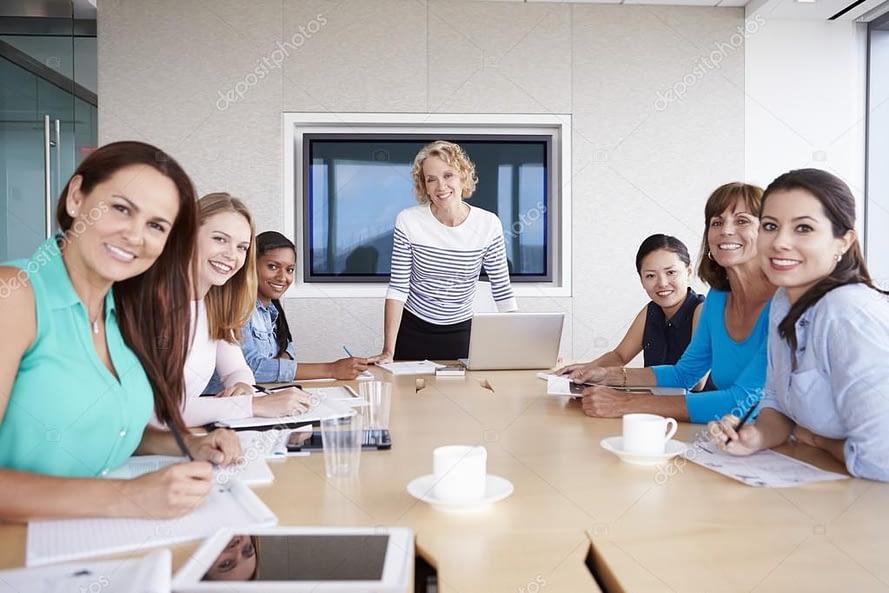 depositphotos 102808880 stock photo group of businesswomen on meeting