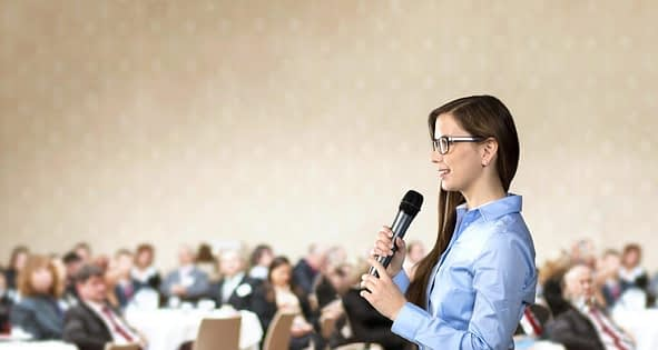 graphicstock beautiful business woman is speaking on conference rRgbIO1i Z 1024x546 1