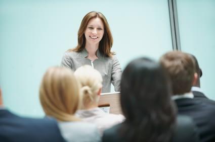 Woman Smiling Public Speaker